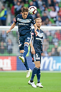 Melbourne Victory midfielder Raul Baena (15) heads the ball at the Hyundai A-League Round 2 soccer match between Melbourne Victory and Perth Glory at AAMI Park in Melbourne.