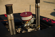 An engine detail is portrayed as a contests car sits idle before the demolition derby at the Summitt County Fairgrounds, Thursday, July 26, 2016 in Tallmadge, Ohio.