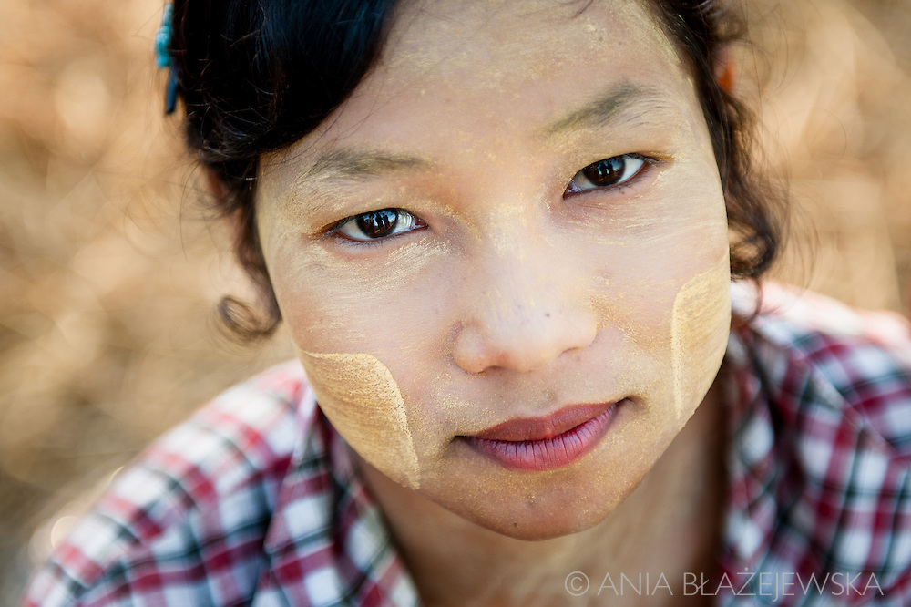 Myanmar, Ngapali. Portrait of a girl who wears thanaka on her face.<br />