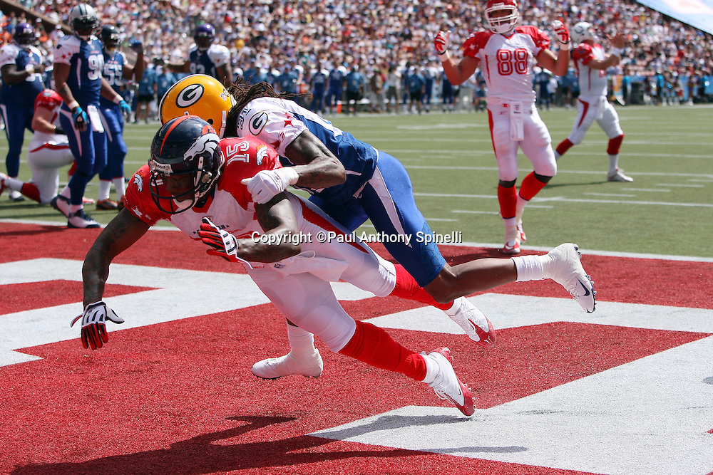 HONOLULU, HI - FEBRUARY 08: AFC All-Stars wide receiver Brandon Marshall #15 of the Denver Broncos tries to catch an end zone pass broken up by cornerback Al Harris #31 of the Green Bay Packers of the NFC All-Stars in the 2009 NFL Pro Bowl at Aloha Stadium on February 8, 2009 in Honolulu, Hawaii. The NFC defeated the AFC 30-21. ©Paul Anthony Spinelli *** Local Caption *** Brandon Marshall;Al Harris