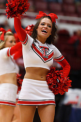 March 19, 2011; Stanford, CA, USA; A Texas Tech Lady Raiders cheerleader performs during the first half of the first round of the 2011 NCAA women's basketball tournament against the St. John's Red Storm at Maples Pavilion. St. John's defeated Texas Tech 55-50.