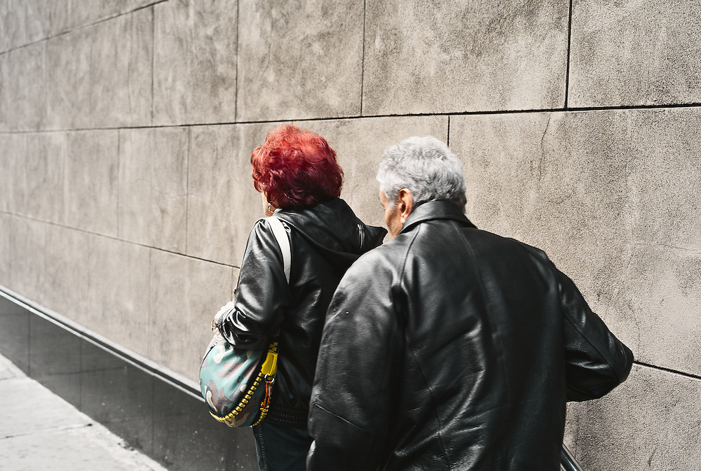 Couple emerging from subway stairway, New York, US