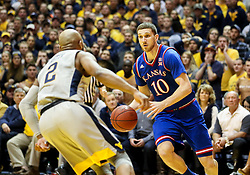 Jan 15, 2018; Morgantown, WV, USA; Kansas Jayhawks guard Sviatoslav Mykhailiuk (10) dribbles to the basket while defended by West Virginia Mountaineers guard Jevon Carter (2) during the first half at WVU Coliseum. Mandatory Credit: Ben Queen-USA TODAY Sports