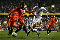 Photo: Paul Thomas.<br /> Tottenham Hotspur v Sevilla. UEFA Cup. Quarter Final, 2nd Leg. 12/04/2007.<br /> <br /> Dimitar Berbatov (R) of Spurs shoots past Javi Navarro.