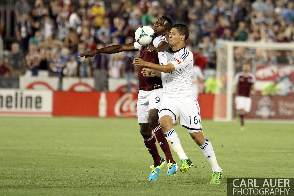 August 17th, 2013 - Colorado Rapids forward Edson Buddle (9) collects the ball and keeps it away from Vancouver Whitecaps FC defender Johnny Leveron (16) in the second half of action in the Major League Soccer match between the Vancouver Whitecaps FC and the Colorado Rapids at Dick's Sporting Goods Park in Commerce City, CO