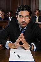 Man sitting in court, portrait