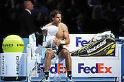 Rafael Nadal with his shirt off at the break during the ATP World Tour Finals at the O2 Arena, London, United Kingdom on 20 November 2015. Photo by Phil Duncan.