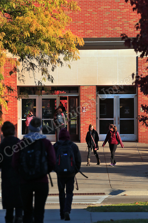Students walk near Pearce Hall. Fall color features scenics at Central Michigan University. Central Michigan University photo by Steve Jessmore