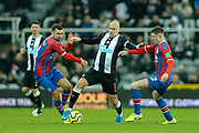 Jonjo Shelvey (#8) of Newcastle United is challenge for the ball by James McArthur (#18) of Crystal Palace and James McCarthy (#22) of Crystal Palace during the Premier League match between Newcastle United and Crystal Palace at St. James's Park, Newcastle, England on 21 December 2019.