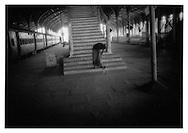 Station dweller greets pariah puppy,  Egmore Station, Madras (Chennai), India.
