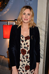 LONDON, ENGLAND 8 DECEMBER 2016: Laura Carmichael at the Omega Constellation Globemaster Dinner at Marcus, The Berkeley Hotel, Wilton Place, London England. 8 December 2016.