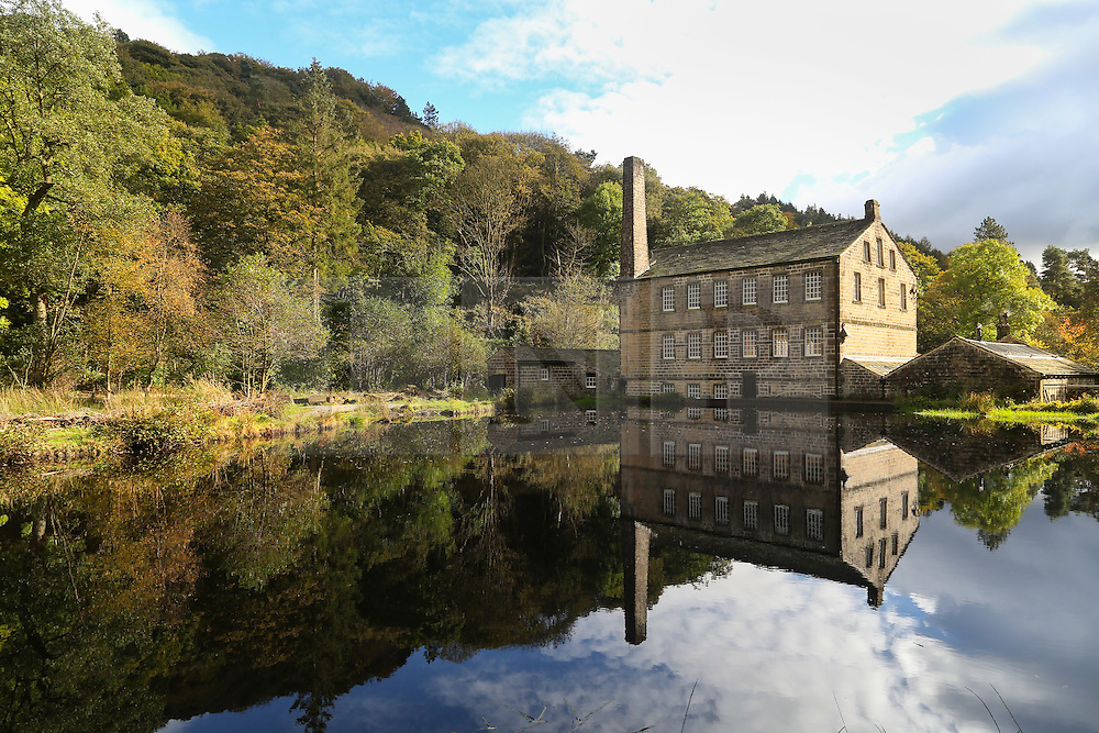 © Licensed to London News Pictures. 19/10/2016. Hebden Bridge, UK. The Gibson Mill reflects in the water on a colourful and sunny autumn day at Hard Castle Crags near Hebden Bridge in West Yorkshire. Photo credit : Ian Hinchliffe/LNP