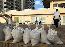One of the disadvantages of beach living is facing major hurricanes. One of the advantages is plenty of sand for do-it-yourself sandbags. Workers at the Atlantic Ocean Club on Galt Ocean Drive in Fort Lauderdale finish protecting the building with the sand they were shoveling from the beach Friday morning Sept. 8, 2017. (Photo by Taimy Alvarez/Sun Sentinel/TNS/Sipa USA)<br />