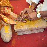 The wedding ring is worn on the toe. In the past, women used to keep their head down so a ring on the toe would symbolize a married person. The men wear the ring on their toe as well.