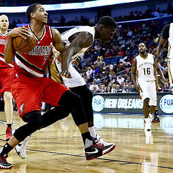 Mar 18, 2016; New Orleans, LA, USA; Portland Trail Blazers guard C.J. McCollum (3) drives past New Orleans Pelicans guard Jrue Holiday (11) during the second quarter of a game at the Smoothie King Center. Mandatory Credit: Derick E. Hingle-USA TODAY Sports