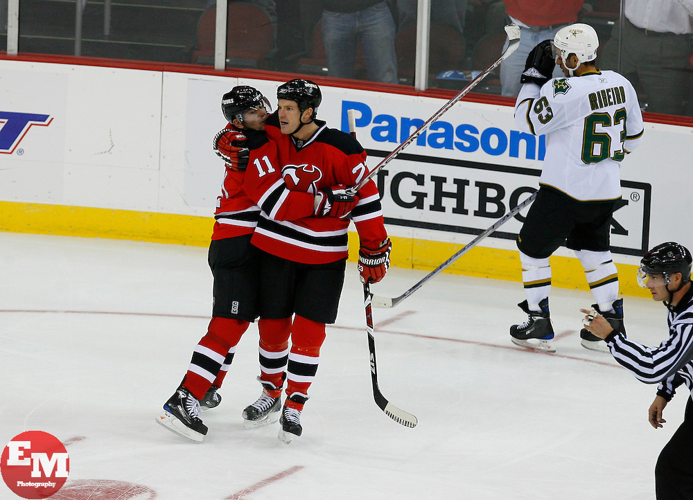 Oct 22, 2008; Newark, NJ, USA; New Jersey Devils center John Madden (11) and New Jersey Devils right wing David Clarkson (23) celebrate Clarkson's goal during the third period at the Prudential Center. The Devils defeated the Stars 5-0.