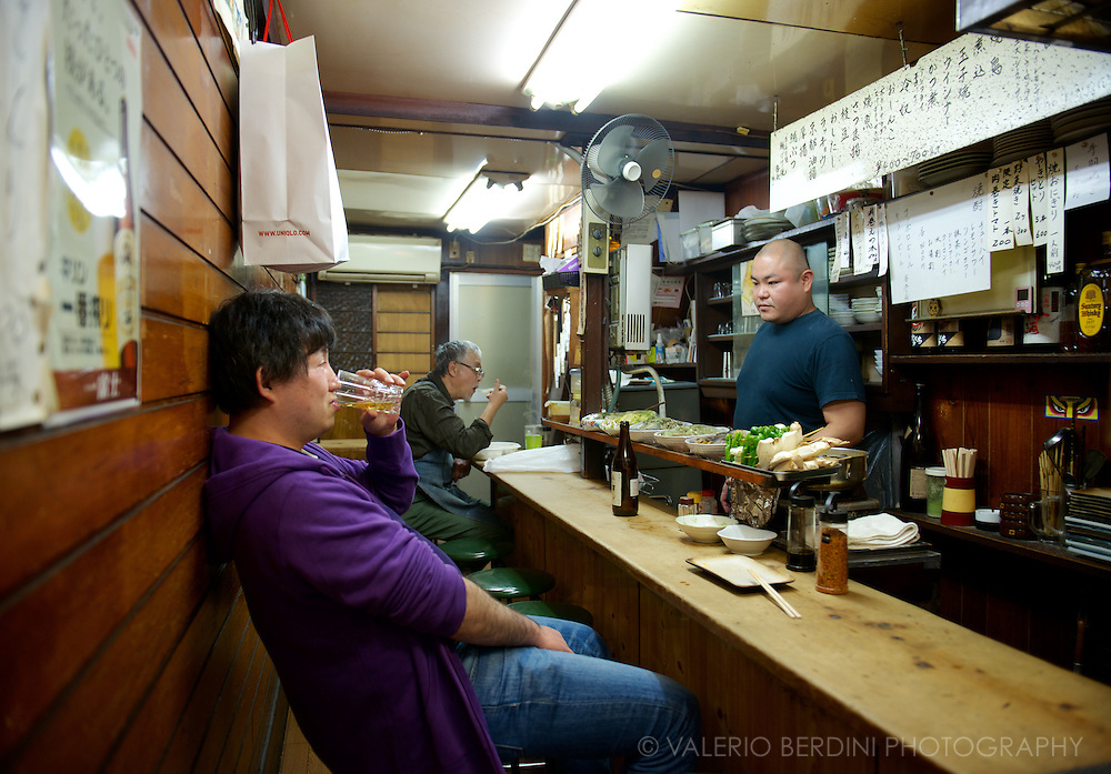 Mostly locals frequent the bars of Memory Lane. They are often friends with the owner and share drinks and snacks over chats and gossip. Tokyo, Japan.