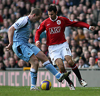 Photo: Paul Thomas.<br /> Manchester United v Manchester City. The Barclays Premiership. 09/12/2006.<br /> <br /> Ryan Giggs (R) of Man Utd tries to get around Richard Dunne of Man City.