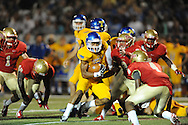 Lafayette High's Eli Murphree (2) vs. Tupelo's Jarvis Wilson (7) in Oxford, Miss. on Friday, August 22, 2014. Tupelo won the season opener 20-0.