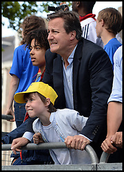 Image ©Licensed to i-Images Picture Agency. 05/07/2014. Yorkshire, United Kingdom.The Prime Minster and his son react as Mark Cavendish crashes off his bike in the Tour de France at finish line in Harrogate on stage one of the race . Picture by Andrew Parsons / i-images