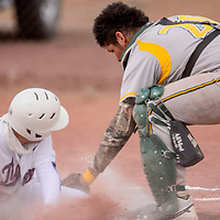 Thoreau Hawks Cordell Joe (20) tags Hot Springs Tiger James Aguirre (11) as he slides home Friday at Thoreau High School.