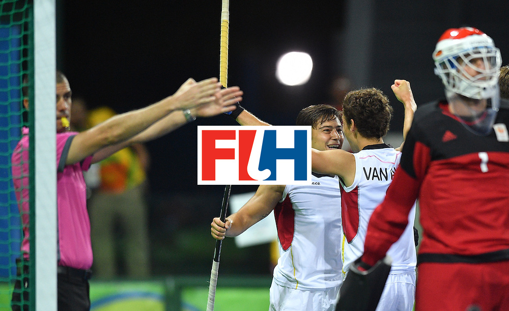 Belgium's Florent van Aubel (2nd R) celebrates a goal with teammate Belgium's Thomas Briels during the men's semifinal field hockey Belgium vs Netherlands match of the Rio 2016 Olympics Games at the Olympic Hockey Centre in Rio de Janeiro on August 16, 2016.  / AFP / Carl DE SOUZA        (Photo credit should read CARL DE SOUZA/AFP/Getty Images)