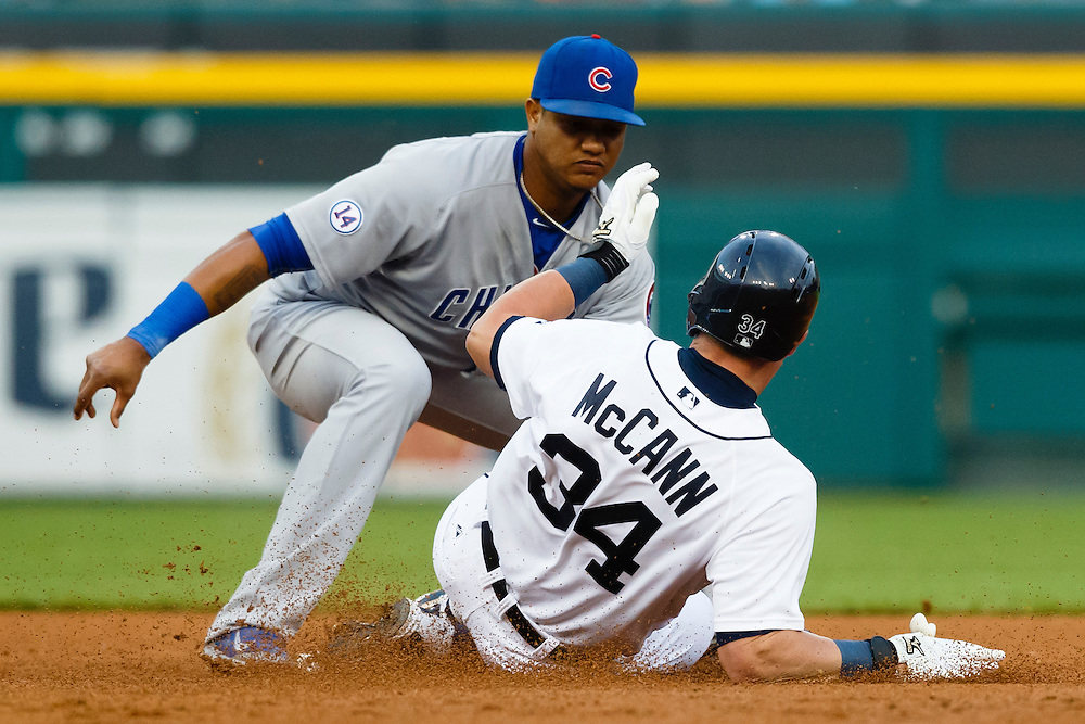 Jun 9, 2015; Detroit, MI, USA; Detroit Tigers catcher James McCann (34) slides in safe at second ahead of the tag by Chicago Cubs shortstop Starlin Castro (13) in the fourth inning at Comerica Park. Mandatory Credit: Rick Osentoski-USA TODAY Sports