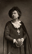 Herbert Beerbohm Tree (1853-1917) English actor-manager.  Founder of  the Royal Academy of Dramatic Art (RADA). Here in about 1892 as the prince in the tragedy 'Hamlet' by William Shakespeare.  Photogravure.
