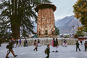 School kids going to school through the Chaurasi temple complex in Bharmaur, Chamba, Himachal Pradesh, India