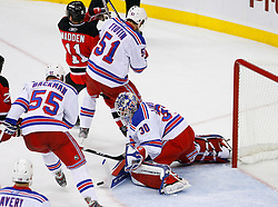 April 9, 2008; Newark, NJ, USA;  New York Rangers defenseman Fedor Tyutin (51) defends against New Jersey Devils center John Madden (11) after a save by New York Rangers goalie Henrik Lundqvist (30) during the first period of game 1 of the Eastern Conference Quarterfinal playoffs at the Prudential Center in Newark, NJ.