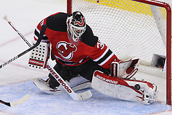 Jan 19; Newark, NJ, USA; New Jersey Devils goalie Martin Brodeur (30) makes a pad save during the third period at the Prudential Center.   The Bruins defeated the Devils 4-1.