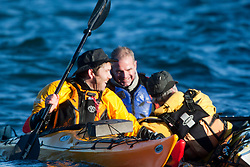 Scottish Sun sports editor Iain King capsizing in a practise session for his charity kayak challenge, in the waters of the harbour at St Abbs. With Richard Harpham..Pic © Michael Schofield...