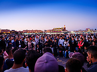 MARRAKESH, MOROCCO - CIRCA APRIL 2018: People gathering in Jemaa el-Fnaa, Marrakesh