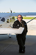 Angel Flight pilot John Ervin stands next to a plane in Springdale, Arkansas.