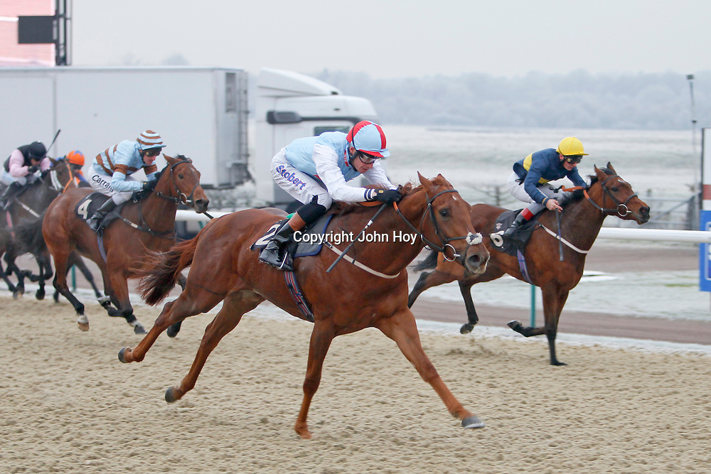Secret Symphony and Richard Hughes winning the 12.00 race