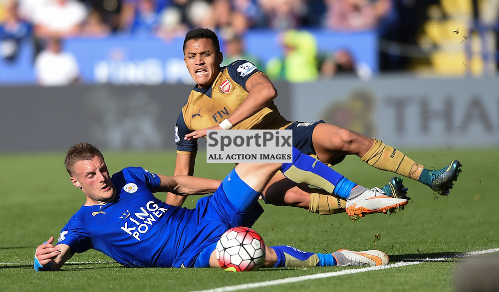 Jamie Vardy slides in to tackle Alexis Sanchez (c) Simon Kimber | SportPix.org.uk