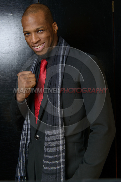 """LONDON, ENGLAND, APRIL 18, 2016: Michael Page poses for a portrait following the event announcement press conference for """"Bellator 158: Slice vs. Thompson"""" inside the Four Seasons Hotel in Park Lane, London (© Martin McNeil)"""