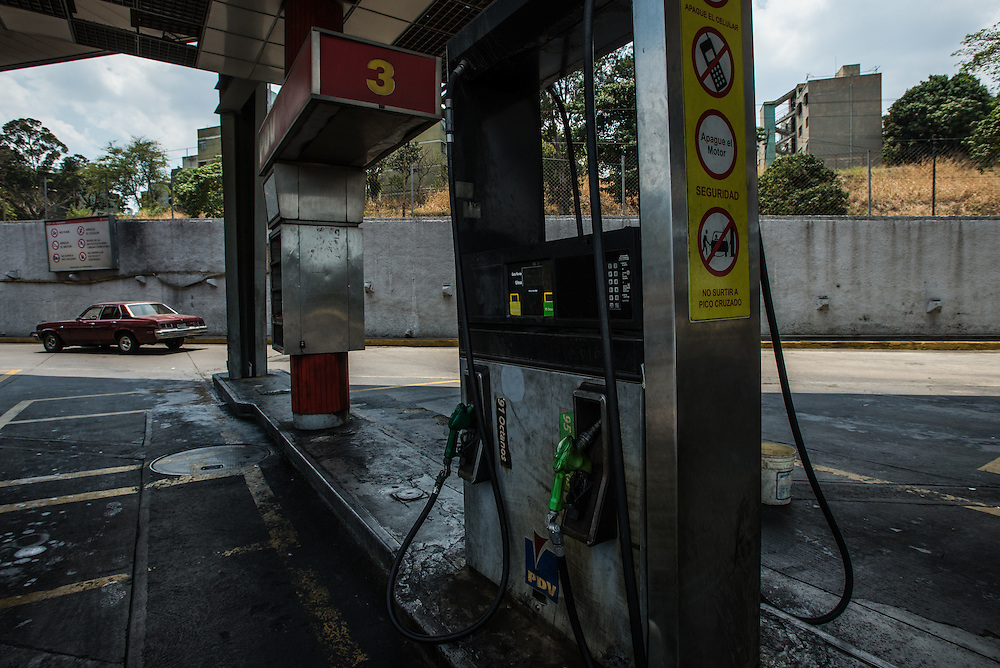 "CARACAS, VENEZUELA - MARCH 21, 2016: A state-run gas station while the electricity was shut off during state-mandated rationing. The pumps need electricity to work, so they had to turn all customers away.  Venezuela is shutting down this week, as the government struggles with a deepening electricity crisis.  President Nicolas Maduro gave everyone an extra three days off work, extending the two-day Easter holiday, according to a statement in the Official Gazette published late last Tuesday.  The government has rationed electricity and water supplies across the country for months and urged citizens to avoid waste as Venezuela endures a prolonged drought that has slashed output at hydroelectric dams. The ruling socialists have blamed the shortage on the El Nino weather phenomena and ""sabotage"" by their political foes, while critics cite a lack of maintenance and poor planning.  PHOTO: Meridith Kohut for Bloomberg News"