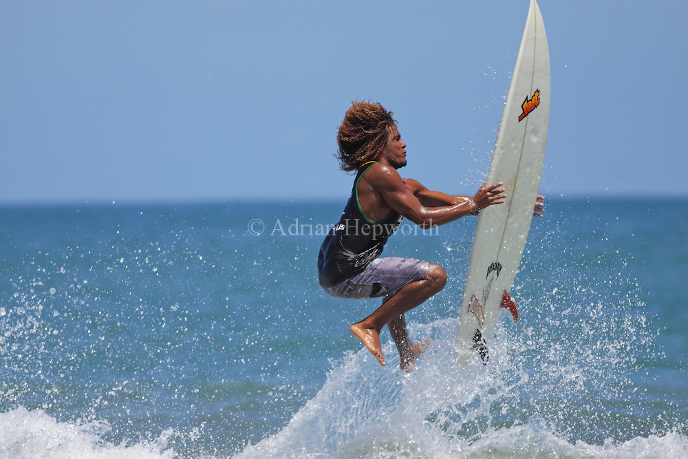 Surfer at Playa Cocles, Puerto Viejo, south Caribbean coast, Costa Rica.<br />
