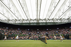 © Licensed to London News Pictures. 19/05/2019. London, UK. Tennis players Kim Clijsters, John McEnroe, Martina Navratilova, and Jamie Murray take part in an exhibition match at the Wimbledon No.1 Court Celebration event. The event marks the unveiling of a retractable roof and extended seating capacity at a cost of £70 million. Photo credit: Ray Tang/LNP