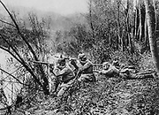 World War I 1914-1918: German riflemen, wearing pickelhelms, firing across the River Aisne,  northeastern France, 1915. Military,  Soldier, Weapon, Smallarms