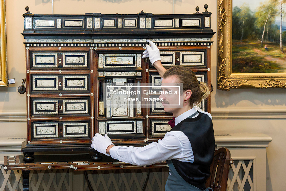 Pictured: Tommy Alexander admires the north Italian 17th Century later ivory and bone inlaid rosewood cabineton stand.<br /> <br /> Bonhams Scotland's next home and interiors sale is aimed at home makers and interior designers with an emphasis on affordability. Items include a north Italian 17th century later ivory bone inlaid rosewood cabinet on stand valued at GBP5000-6000<br /> <br /> Ger Harley | EEm 31 October 2016