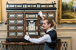 Pictured: Tommy Alexander admires the north Italian 17th Century later ivory and bone inlaid rosewood cabineton stand.<br /> <br /> Bonhams Scotland's next home and interiors sale is aimed at home makers and interior designers with an emphasis on affordability. Items include a north Italian 17th century later ivory bone inlaid rosewood cabinet on stand valued at GBP5000-6000<br /> <br /> Ger Harley   EEm 31 October 2016