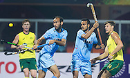 BHUBANESWAR (India) -  Hero Champions Trophy hockey men. Match for bronze. Australia vs India. Sunil Sowmarpet  and Lalit Upadhyay with Nicholas Budgeon R) of Australia.   Photo Koen Suyk