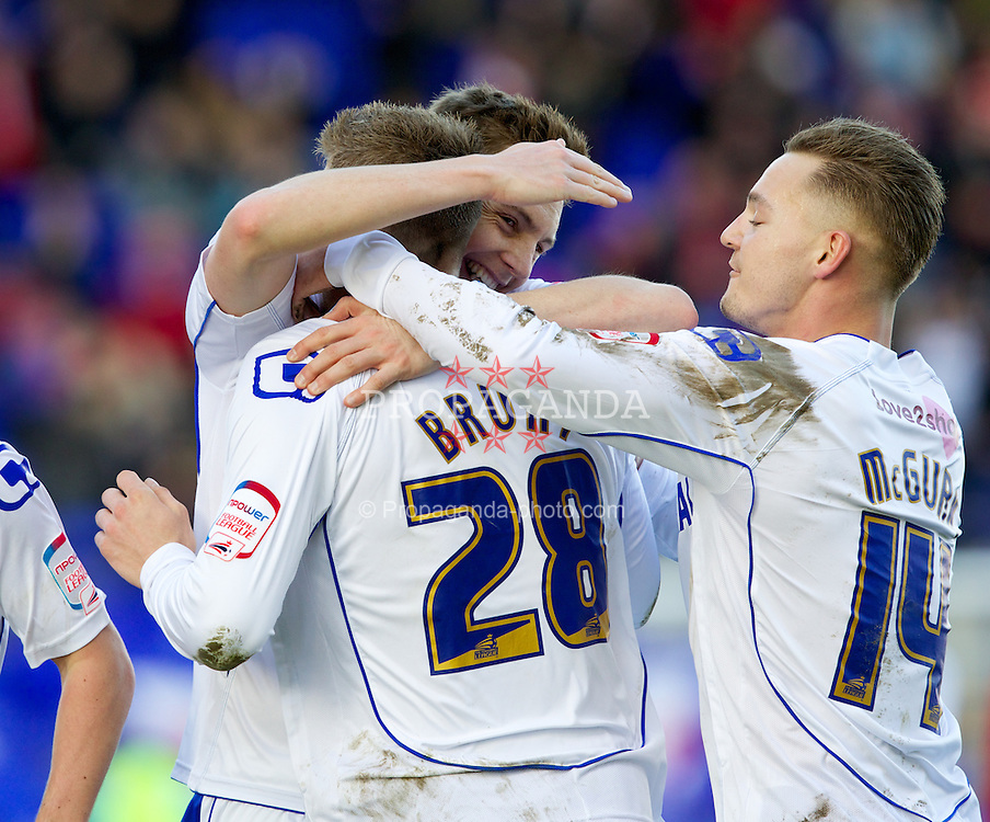 BIRKENHEAD, ENGLAND - Saturday, February 18, 2012: Tranmere Rovers' Ryan Brunt celebrates scoring the first goal against Charlton Athletic with team-mates Adam McGurk and Ash Taylor during the Football League One match at Prenton Park. (Pic by Vegard Grott/Propaganda)