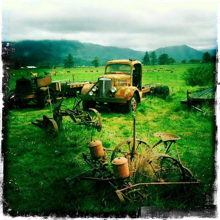 Antique farm equipment, Tillamook Oregon. Hipstamatic digital photograph. The Oregon Coast, a classic, beautiful road trip. Heading West from Portland to Tillamook, with a detour to the fishing village of Garibaldi, through Cape Lookout State Park and on to our final destination of Pacific City.