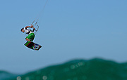 GOLD COAST, AUSTRALIA - DECEMBER 10: Reno Romeu of Brazil preforms a 360 air during the Freestyle Competition of the 2010 Gold Coast Kitesurfing Pro World Tour Event at Main Beach on December 10, 2010 in Gold Coast, Australia. (Photo by Matt Roberts/Getty Images)