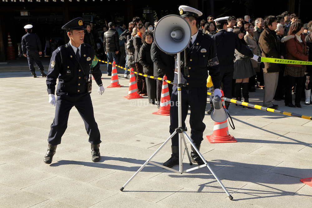 Japanese police during the new year celebration having to control the crowd