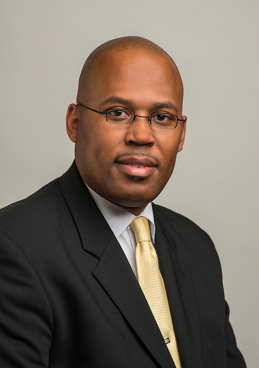 Chief Human Resources Officer Rodney Watson poses for a photograph, December 20, 2013.