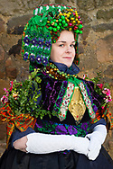Tamara, member of the 'Schw&auml;lmer Tanz- und Trachtengruppe' is wearing an original traditional bridal costume in Schreckshausen, Hesse, Germany on December 4, 2016.<br /> <br /> It took 3 hours to dress Tamara in the original costume. All ribbons on the head and back are pinned together with about 200 pins. The flowers on the arms stand for the wish of having many kids. The Schw&auml;lmer Tracht (Traditional Costume of the Schwalm area) is the only one in Germany where the groom also wore an elaborate headpiece.<br /> Only pristine women were allowed to wear the bridal crown.<br /> <br /> This is part of the series about Traditional Wedding Gowns from different regions of Germany, worn by young members of local dance groups and cultural associations that exist to preserve and celebrate the cultural heritage. The portraiture series is a depiction of an old era with different social values and religious beliefs in an antiquated civil society with very few of those dresses left.
